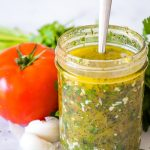 italian salad dressing in a mason jar with a spoon