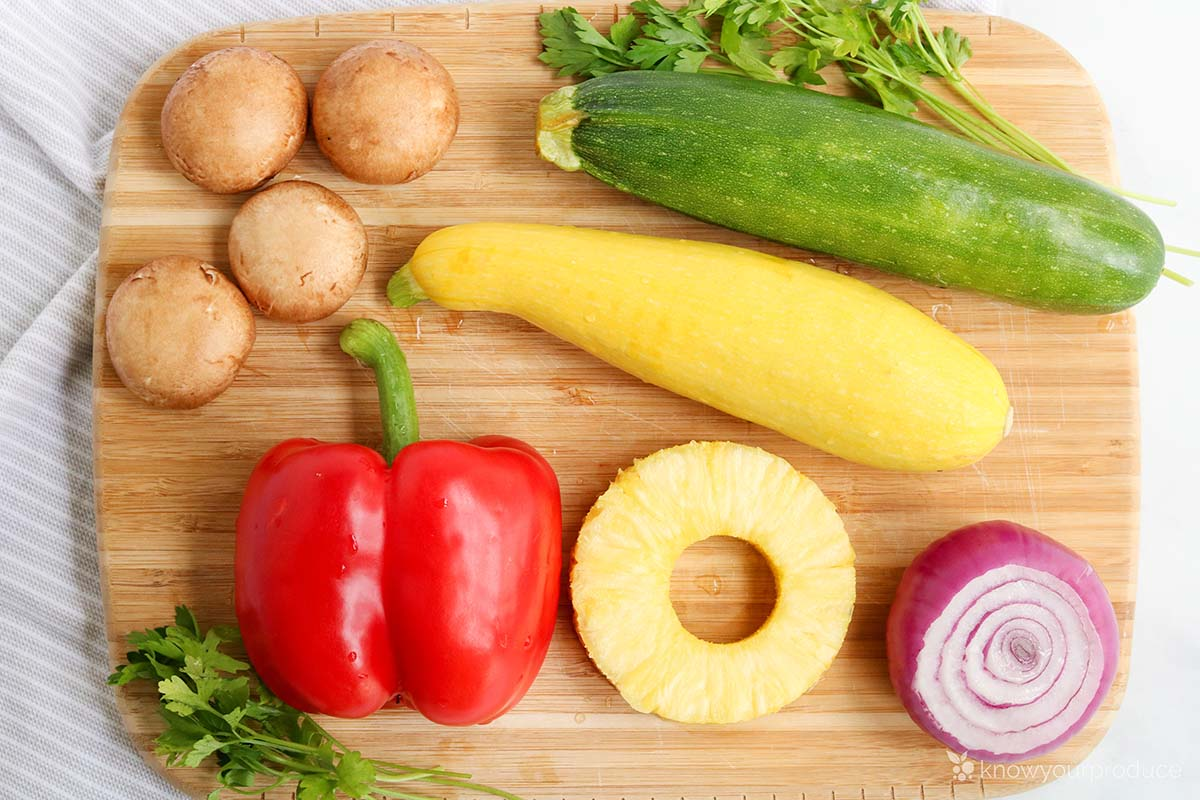 ingredients for vegetable kabobs on a cutting board